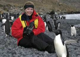 Becci Crowe with penguins in Antarctica